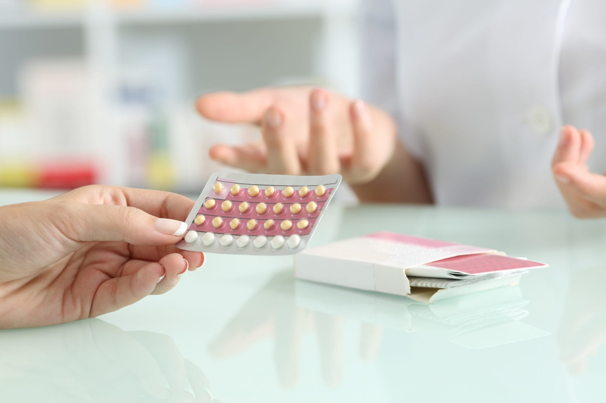 Girl buying contraceptive pills in a pharmacy